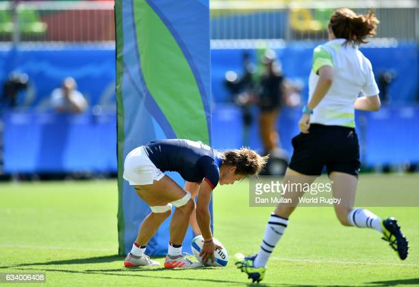 Camille Grassineau of France scores the opening try during the Women's Rugby Sevens Pool B match between France and Spain on Day 1 of the 2016 Rio...