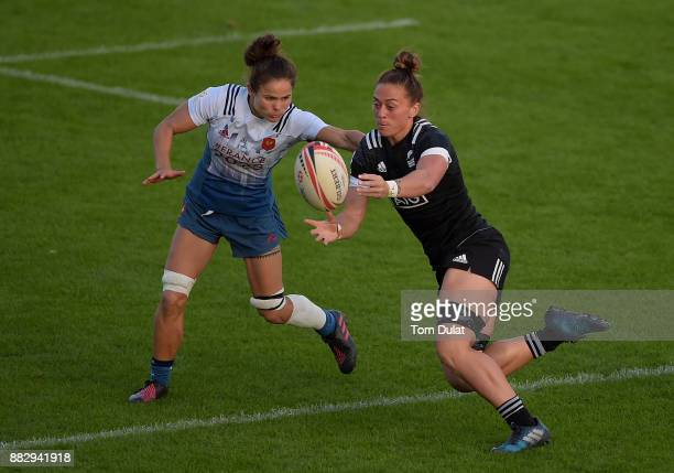 Camille Grassineau of France tackles Niall Williams of New Zealand during the match between New Zealand and France on Day One of the Emirates Dubai...