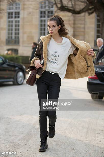 Camille Hurel wears a 'We Should All Be Feminist' Dior shirt at the Dior Couture show at Musee Rodin on January 23 2017 in Paris France