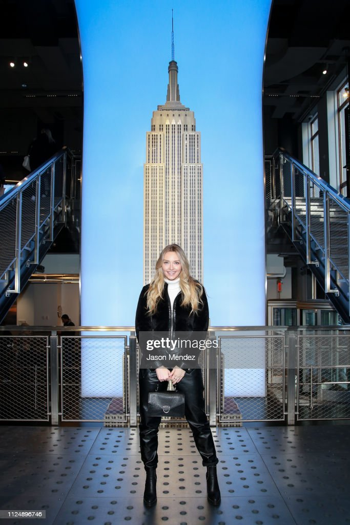 Model Camille Kostek Visits Empire State Building : News Photo