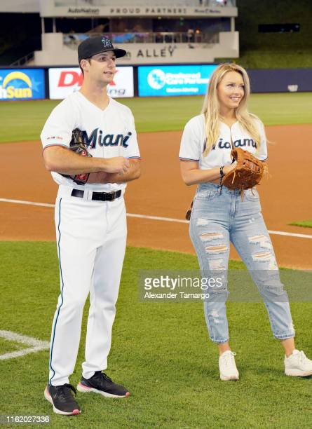 Camille Kostek poses as Sports Illustrated Swimsuit Model Search Winner Brooks Nader Throws First Pitch At The Miami Marlins Vs New York Mets Game at...