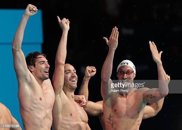 Camille Lacourt Fabien Gilot and Jeremy Stravius of France celebrate after the USA are disqualified and they are instated as winners of the Swimming...