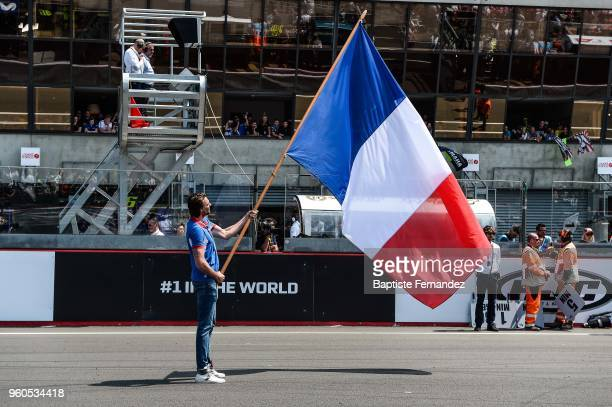 Camille Lacourt is the flag bearer during the Moto GP Grand Prix de France at Circuit Bugatti on May 20 2018 in Le Mans France