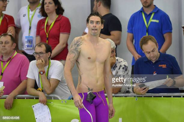 Camille Lacourt reacts after winning the 50m Men's Individual Backstroke Final and his qualification for the World Cup on day five of the French...