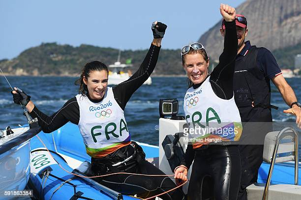 Camille Lecointre of France and Helene Defrance of France celebrate winning bronze medal in the Women's 470 class at the Marina da Gloria on Day 13...
