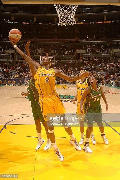 Camille Little and Kristen O'Neill of the Seattle Storm defend against a shot from Lisa Leslie of the Los Angeles Sparks during Game One of the...