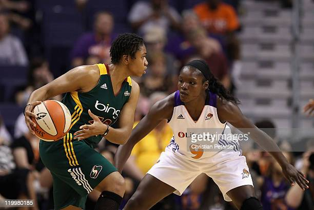 Camille Little of the Seattle Storm looks to pass around Marie FerdinandHarris of the Phoenix Mercury during the WNBA game at US Airways Center on...