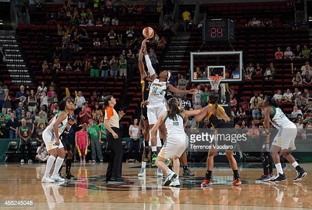 Camille Little of the Seattle Storm tips off against the Tulsa Shock during the game on August 102014 at Key Arena in Seattle Washington NOTE TO USER...