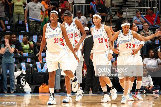 Camille Little Stacey Lovelace Tamera Young Betty Lennox and Ivory Latta of the Atlanta Dream walk on the court during the WNBA game against the...