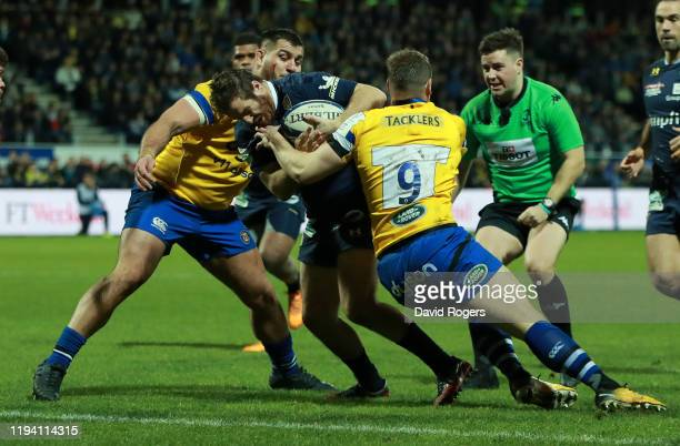 Camille Lopez of Clermont Auvergne holds off Chris Cook to score a try during the Heineken Champions Cup Round 4 match between ASM Clermont Auvergne...