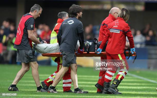 Camille Lopez of Clermont Auvergne is carried off after breaking his left leg during the European Rugby Champions Cup match between ASM Clermont...