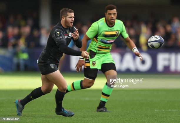Camille Lopez of Clermont Auvergne passes the ball as Luther Burrell looks on during the European Rugby Champions Cup match between ASM Clermont...