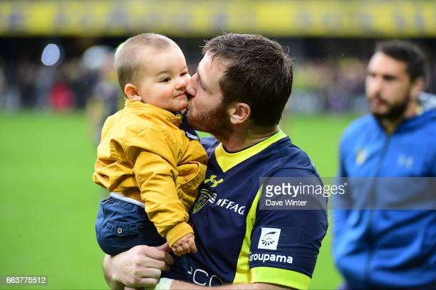 Camille Lopez of Clermont kisses one of his children after his side wins the European Champions Cup quarter final match between Clermont and Toulon...