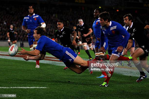 Camille Lopez of France gets a pass away during the first test match between the New Zealand All Blacks and France at Eden Park on June 8 2013 in...