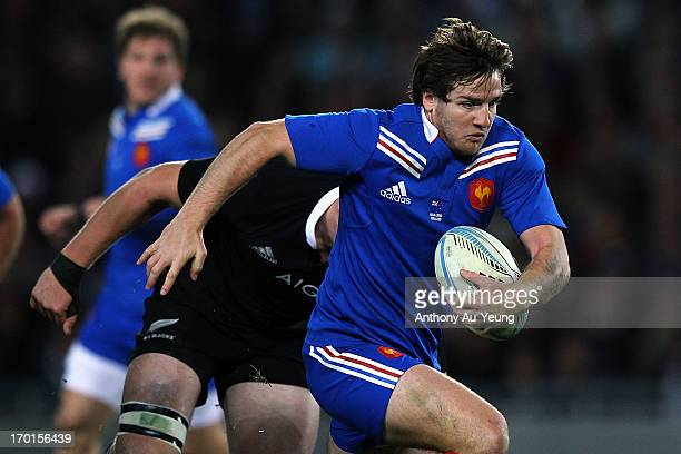 Camille Lopez of France makes a break during the first test match between the New Zealand All Blacks and France at Eden Park on June 8 2013 in...
