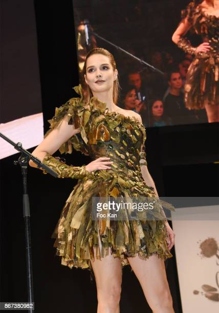 Camille Lou by Nicolas Fafiotte Dragees Reynaud walks the runway during the 'Salon Du Chocolat 2017 Chocolate Fair' Auction Show in Benefit of...