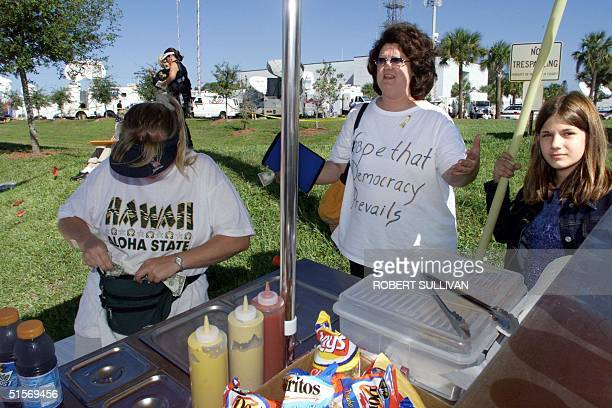 Camille Oliver a resident of Pennsylvania who came down to Florida to witness and participate in the Florida vote recount issue, wears a t-shirt that...
