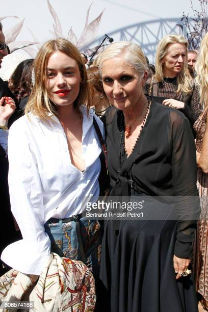 Camille Rowe and Stylist Maria Grazia Chiuri pose backstage after the Christian Dior Haute Couture Fall/Winter 20172018 show as part of Haute Couture...
