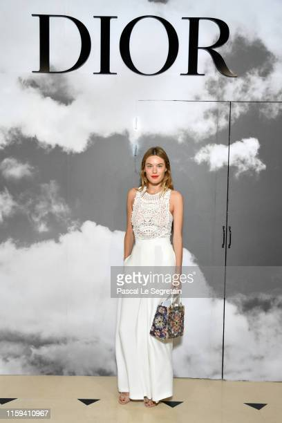 Camille Rowe attends the Christian Dior Haute Couture Fall/Winter 2019 2020 show as part of Paris Fashion Week on July 01 2019 in Paris France