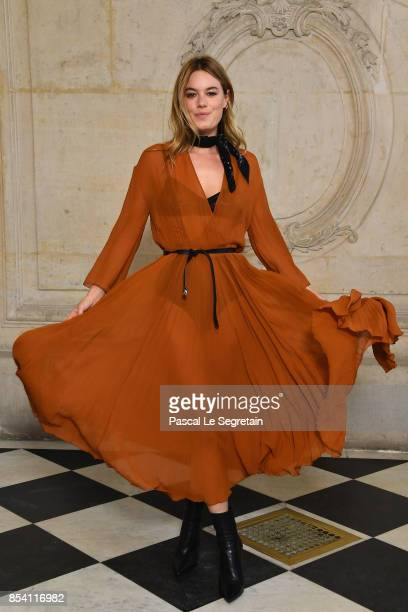 Camille Rowe attends the Christian Dior show as part of the Paris Fashion Week Womenswear Spring/Summer 2018 on September 26 2017 in Paris France
