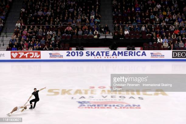 Camille Ruest and Andrew Wolfe of Candada perform during pairs short program in the ISU Grand Prix of Figure Skating Skate America at the Orleans...