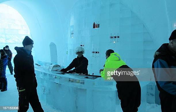 Camille-Marie BAS-WOHLERT This picture taken on March 10, 2012 shows guests in the bar of the new Ice Hotel in the village of Jukkasjarvi, near...