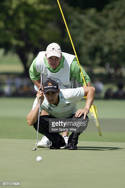 Camillo Villegas and caddie Gary Matthews analyze the 3rd green during the first round of the 89th PGA Championship at Southern Hills Country Club in...