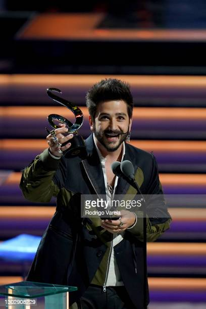 Camilo accepts the award for Pop Album of The Year onstage during Univision's 33rd Edition of Premio Lo Nuestro a la Música Latina at...