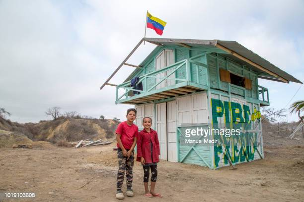 Camilo and Keren Perez Rincón pose as they sell fruit in front of their house alongside the road on August 13 2018 in Tumbes Peru Most Venezuelans...