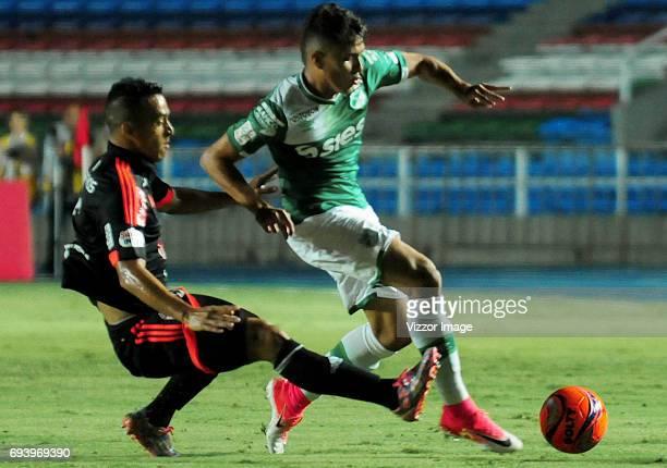 Camilo Ayala of America Cali struggles the ball with Andres Felipe Roa of Deportivo Cali during the match between America de Cali and Deportivo Cali...