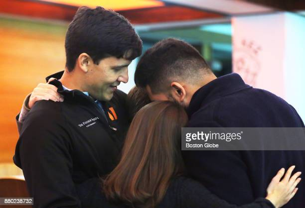Camilo Caballero left a grad student at Tufts University's Fletcher School of Law and Diplomacy gets a hug from supporters on campus in Medford MA on...