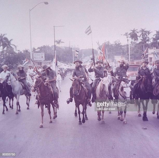 Camilo Cienfuegos proCastro rebel army leader waving riding horseback w some of his troops upon entering city triumphantly day of huge victory...
