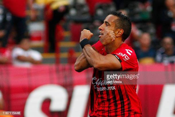 Camilo Da Silva celebrates after scoring the first goal of his team during the 4th round match between Tijuana and Pumas UNAM as part of the Torneo...