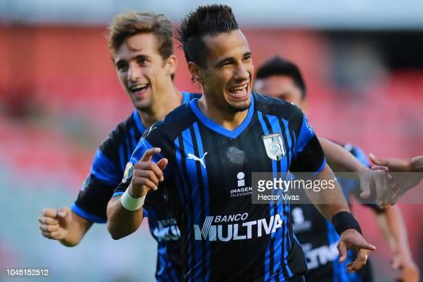 Camilo Da Silva of Queretaro celebrate with teammates after scoring the first goal of his team during a match between Queretaro and Dorados as part...