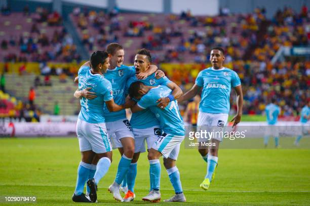 Camilo Da Silva of Queretaro celebrates with teammates after scoring the first goal during the 8th round match between Morelia and Queretaro as part...