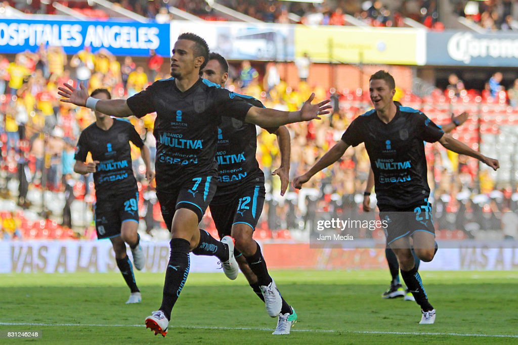 Camilo Da Silva Sanvezzo (L) of Queretaro celebrates the second goal of his team during the 4th round match between Queretaro and Morelia as part of the Torneo Apertura 2017 Liga MX at Corregidora Stadium on August 12, 2017 in Mexico City, Mexico.