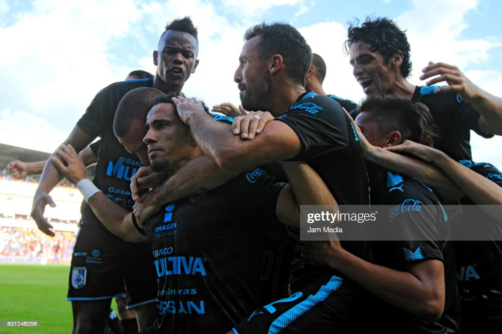 Camilo Da Silva Sanvezzo (L) of Queretaro celebrates with teammates the second goal of his team during the 4th round match between Queretaro and Morelia as part of the Torneo Apertura 2017 Liga MX at Corregidora Stadium on August 12, 2017 in Mexico City, Mexico.