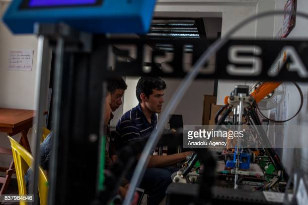 Camilo Hurtado 26yearold 3D Expert designer teaches people print process in Bogota Colombia on August 05 2017 A group of volunteers of the nonprofit...