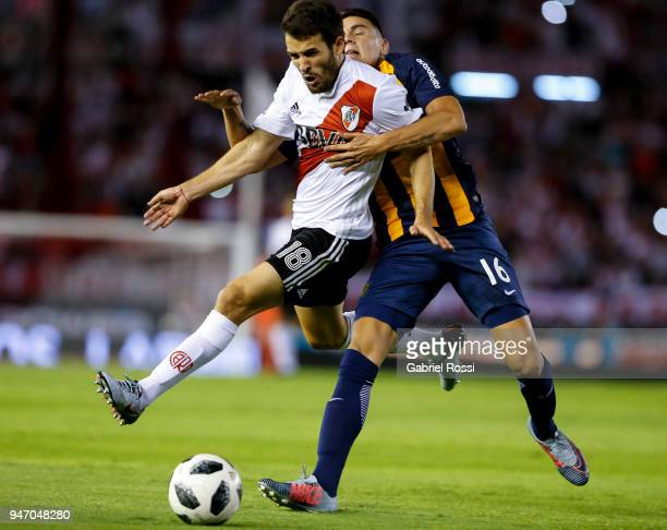 Camilo Mayada of River Plate fights for the ball with Mauricio Martinez of Rosario Central during a match between River Plate and Rosario Central as...