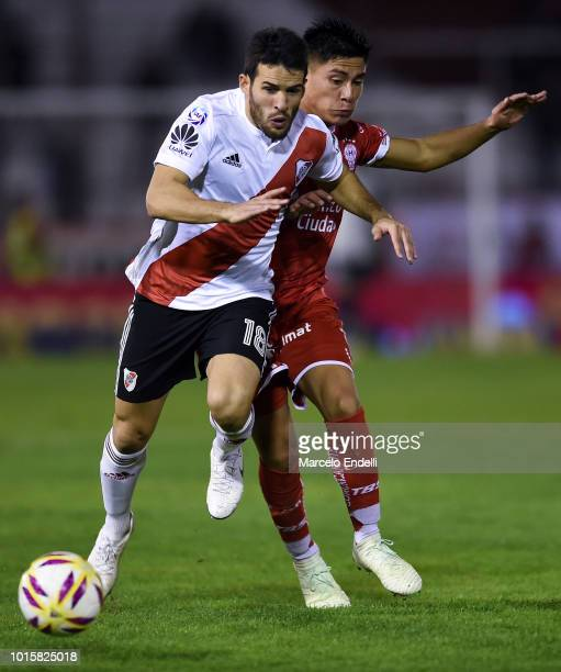 Camilo Mayada of River Plate fights for the ball with Walter Perez of Huracan during a match between Huracan and River Plate as part of Superliga...