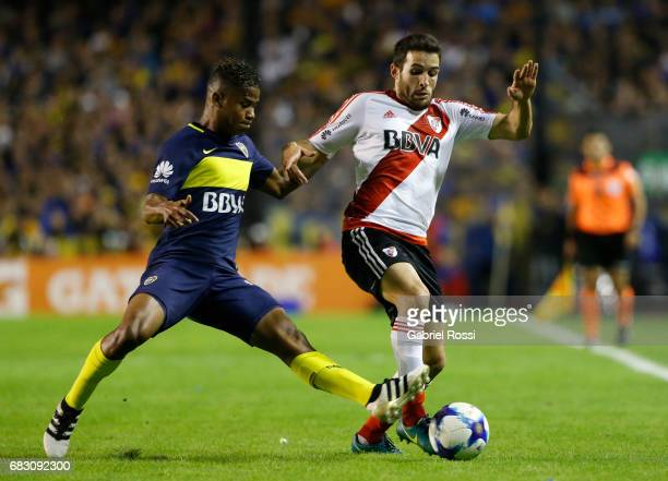 Camilo Mayada of River Plate fights for the ball with Wilmar Barrios of Boca Juniors during a match between Boca Juniors and River Plate as part of...