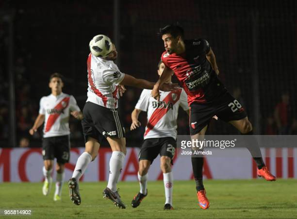 Camilo Mayada of River Plate goes for a header with Marcelo Estigarribia of Colon during a match between Colon and River Plate as part of Superliga...