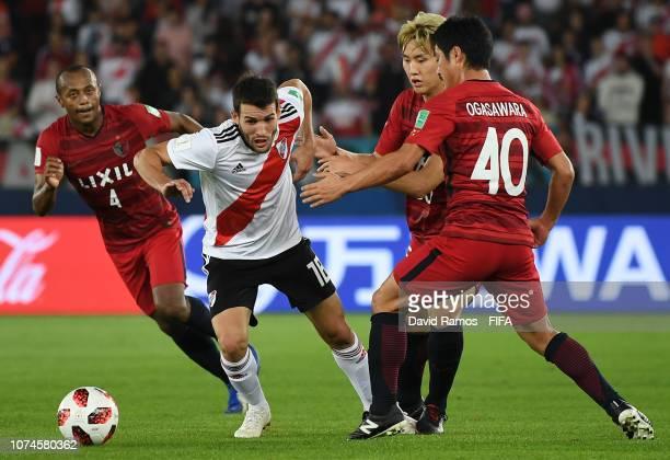Camilo Mayada of River Plate is challenged by Hugo Leonardo of Kashima Antlers Seunghyun Jung of Kashima Antlers and Mitsuo Ogasawara of Kashima...