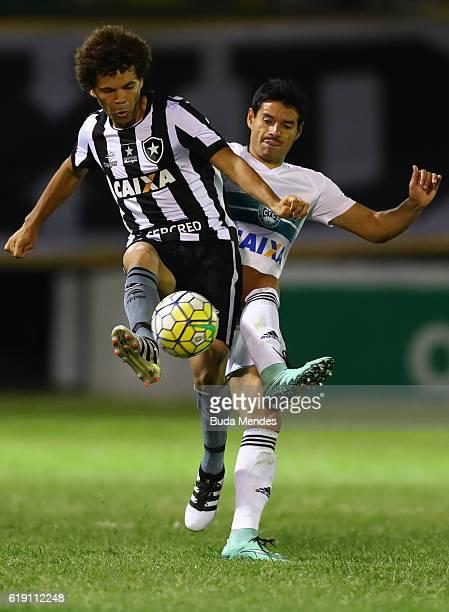 Camilo of Botafogo struggles for the ball with Csar Bentez of Coritiba during a match between Botafogo and Coritiba as part of Brasileirao Series A...