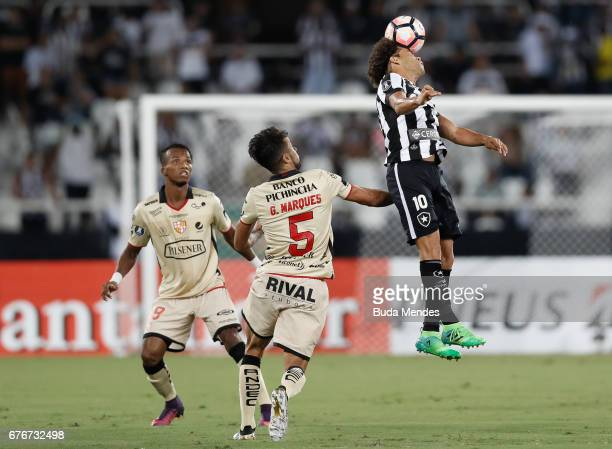 Camilo of Botafogo struggles for the ball with Gabriel Marques of Barcelona de Guayaquil during a match between Botafogo and Barcelona de Guayaquil...