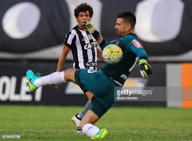 Camilo of Botafogo struggles for the ball with goalkeeper Victor of Atletico Mineiro during a match between Botafogo and Atletico Mineiro as part of...