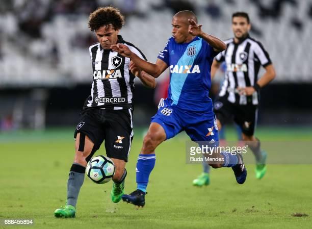 Camilo of Botafogo struggles for the ball with Nino Paraba of Ponta Preta during a match between Botafogo and Ponta Preta part of Brasileirao Series...