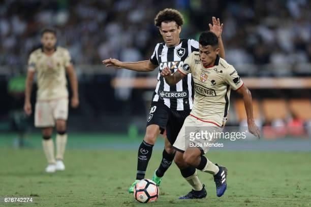 Camilo of Botafogo struggles for the ball with Richard Calderon of Barcelona de Guayaquil during a match between Botafogo and Barcelona de Guayaquil...