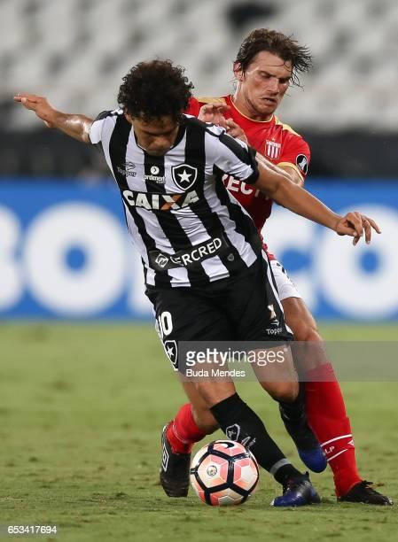 Camilo of Botafogo struggles for the ball with Sebastin Dubarbier of Estudiantes during a match between Botafogo and Estudiantes as part of Copa...