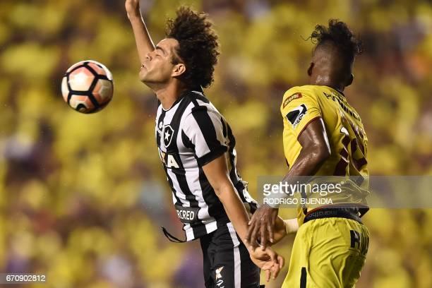 Camilo of Brazil's Botafogo vies for the ball with Dario Aimar of Ecuador's Barcelona during their 2017 Copa Libertadores football match at...